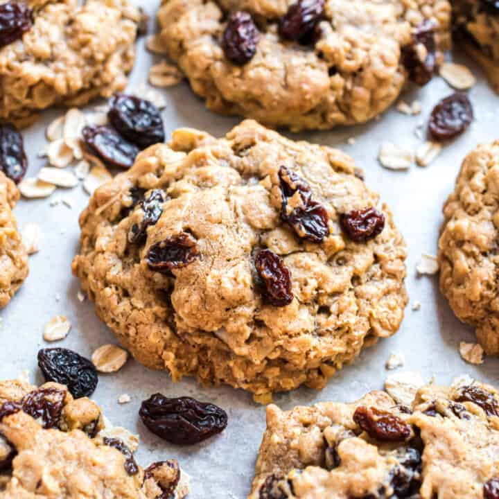 Oatmeal raisin cookies on parchment paper.