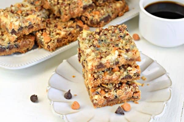 7 Layer Cookie Bars Recipe topped with coconut, pecans, chocolate and butterscotch. You'll love this easy Magic Bar recipe any time of year!