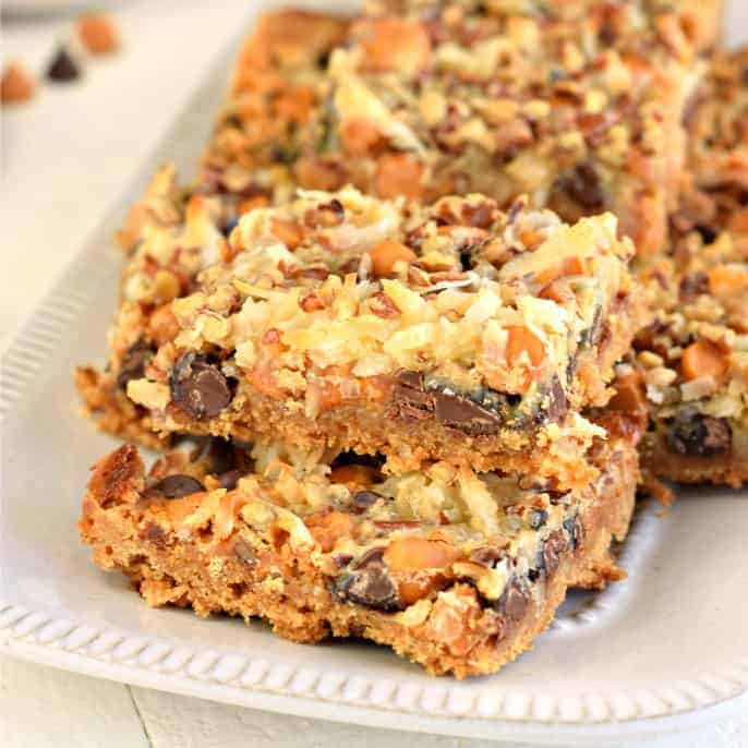 7 Layer Cookie Bars Recipe topped with coconut, pecans, chocolate and butterscotch.