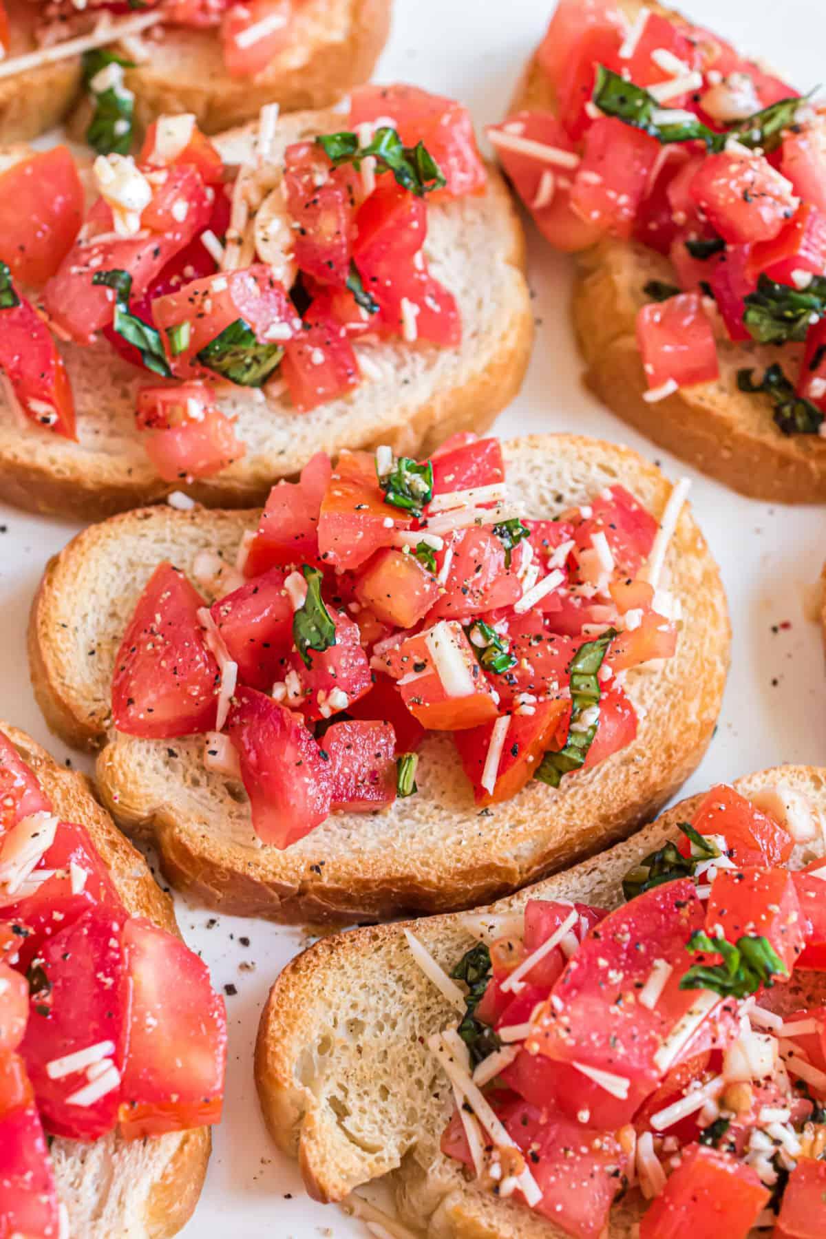 Bruschetta on small slices of toasted bread.