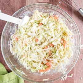 If you're looking to make the very best coleslaw recipe, this copycat Chick-fil-A Cole Slaw is made for you! Creamy and delicious, it's the perfect potluck recipe.