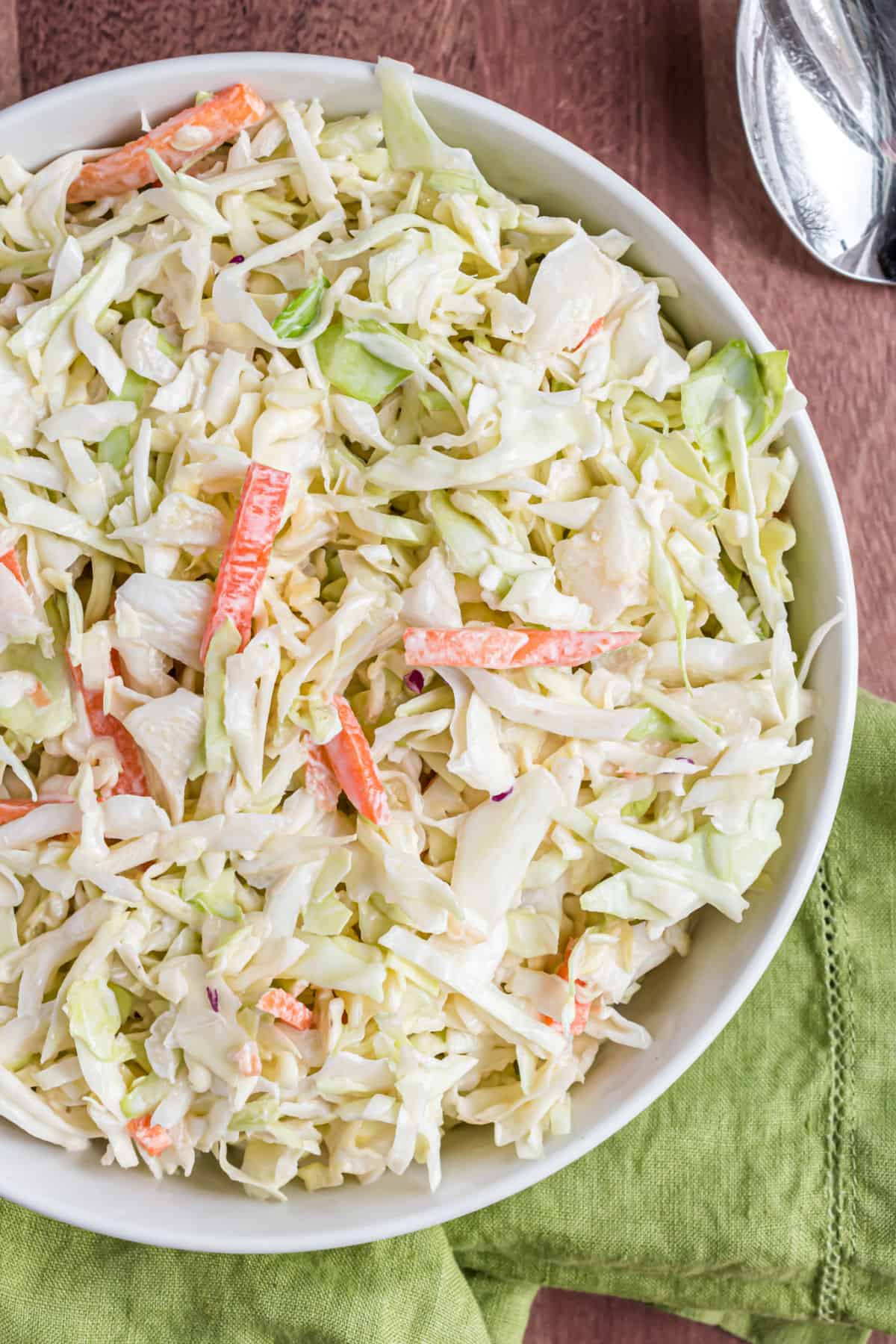 Coleslaw in a white bowl for serving.
