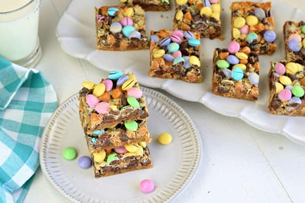 The BEST, Easy Magic Cookie Bars recipe is now at your fingertips. You'll love this 7 layer, chewy treat, that's so versatile for holidays or any day!