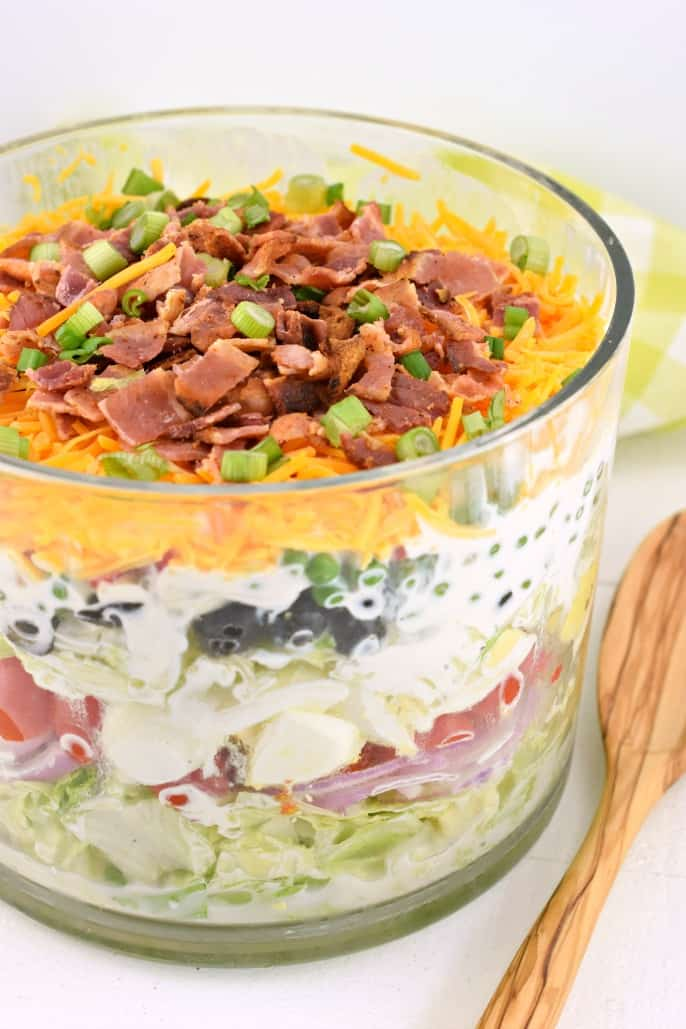 Layered salad in a trifle bowl.