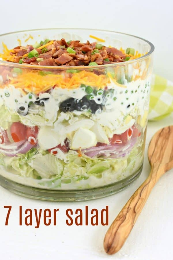 A classic, easy 7 layer Salad recipe served in a trifle bowl. So many options for the seven layers, you choose what you love. Perfect for potlucks!