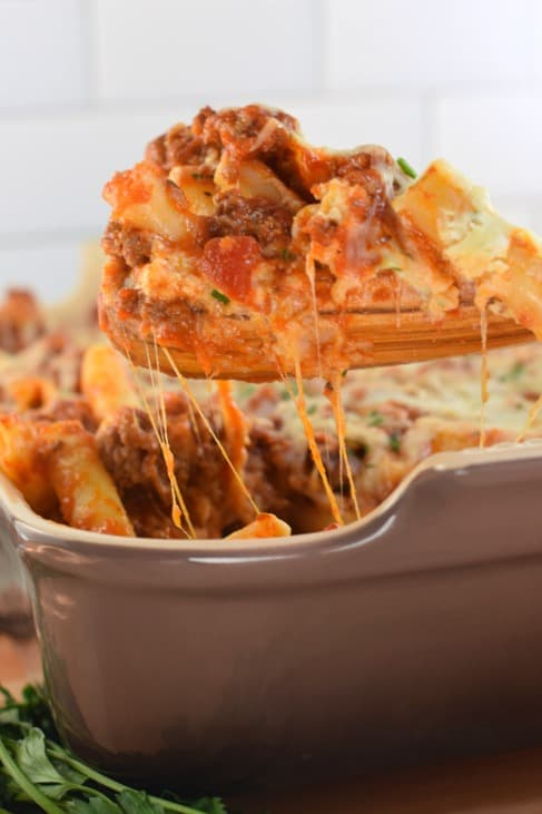 Spoonful of baked ziti with cheese pull