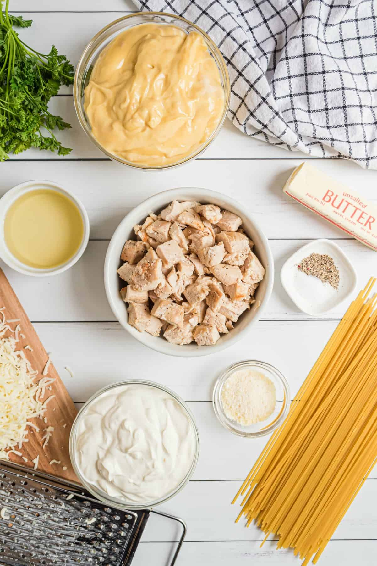 Ingredients you'll need to make chicken tetrazzini, including cooked chicken, pasta, cream of chicken soup and more.