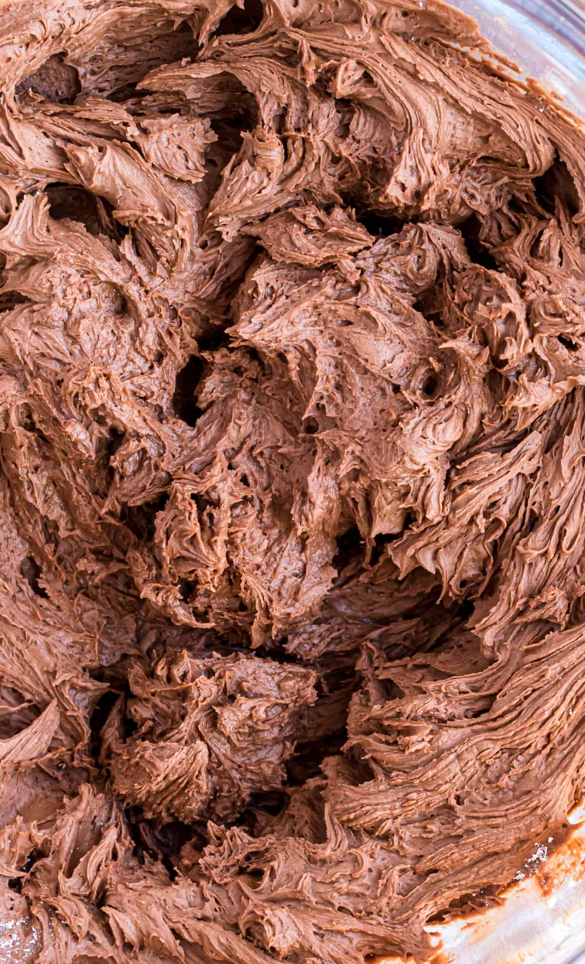Close up photo of chocolate buttercream frosting.