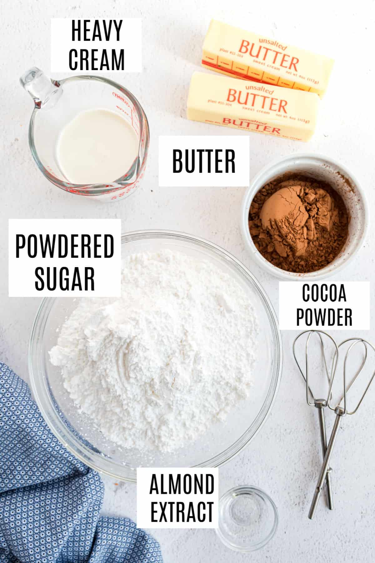 Ingredients needed to make homemade buttercream frosting with chocolate.