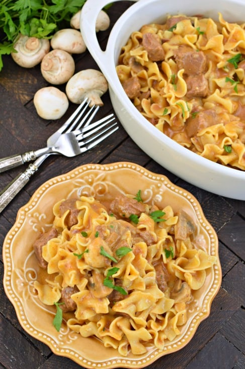 Instant Pot Beef Stroganoff served on a yellow plate with a dish of beef stroganoff in a white bowl.