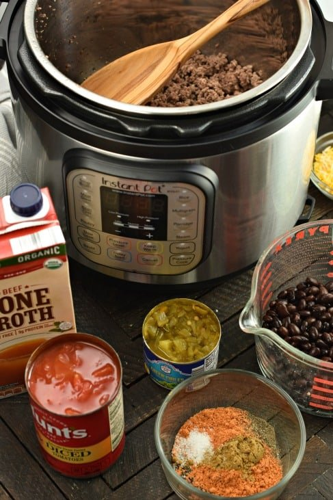 Instant Pot with ingredients to make taco soup.
