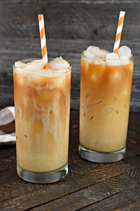 Pumpkin Cream Cold Brew Coffee in tall glass with orange and white straw