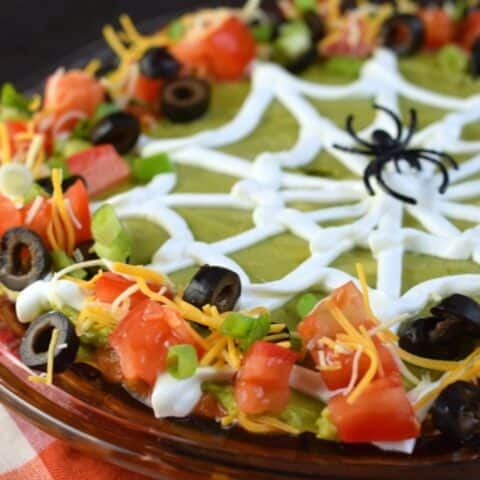 7 layer taco dip with halloween spider web.