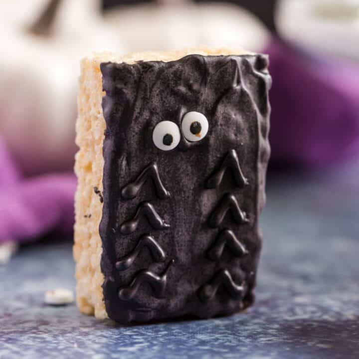 Halloween rice krispie treat with chocolate and candy eyes to represent a spider.