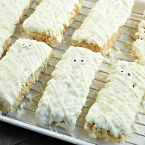 Rice krispie treats with white chocolate and decorated to look like mummies.