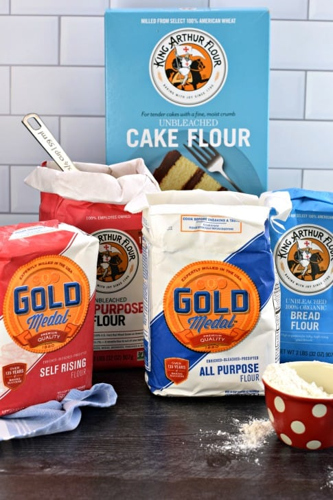 Five different types of flour in their original packaging.