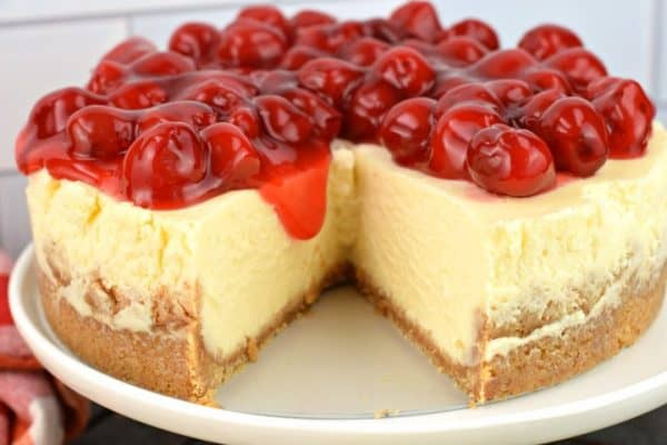 Instant Pot Cheesecake with cherry pie filling on top.