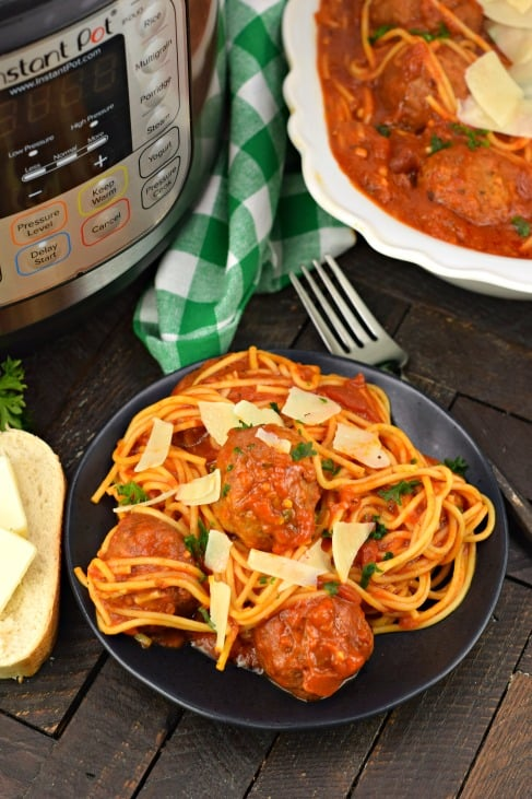 Instant Pot Spaghetti and Meatballs recipe on a plate with bread.