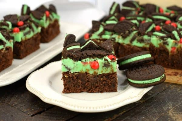 Thick and fudgy Chocolate Brownies. Grinch brownies with a green mint ganache, mint Oreos, and red hot candies! Perfect for Christmas.