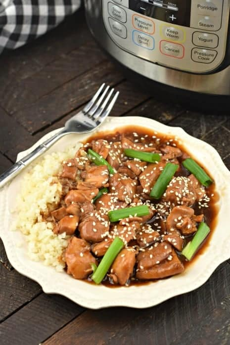 Plate of mongolian chicken made in the pressure cooker and served with rice.
