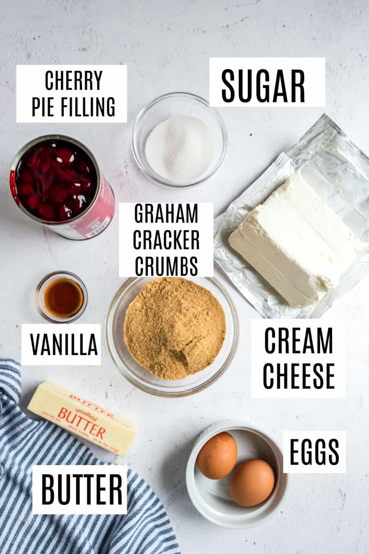 Ingredients needed to make mini cherry cheesecakes.