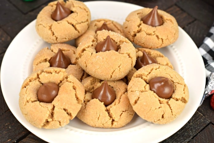 White plate with peanut butter kiss cookies.