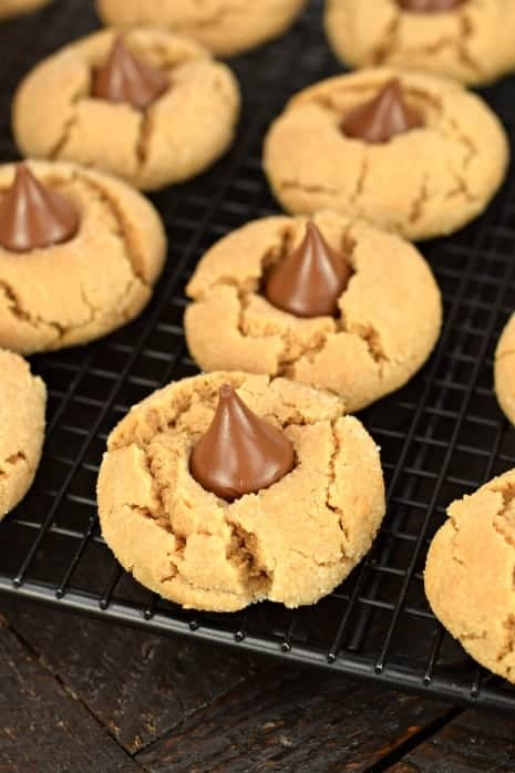 Soft and chewy peanut butter cookies with a Hershey kiss pressed on top.