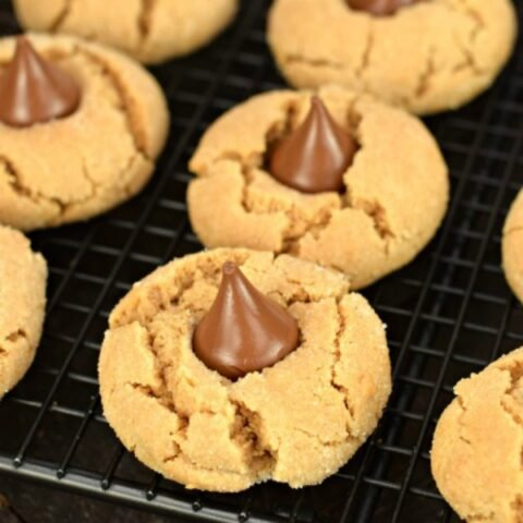 Peanut butter blossom cookies on a wire rack.