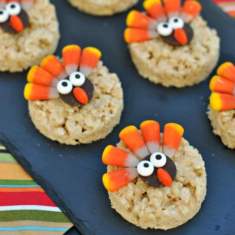 Easy to assemble Turkey Rice Krispie Treats decorated for Thanksgiving! Soft and chewy krispie treats with an adorable turkey topping! Let the kids help create their own!