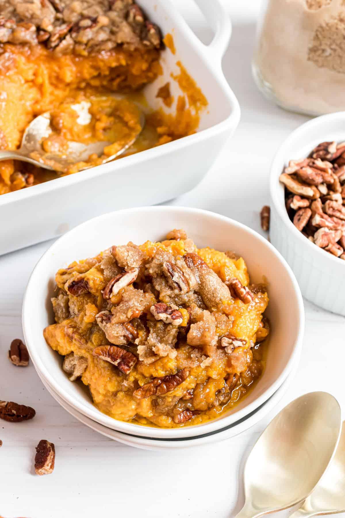 Sweet potato casserole recipe served in white bowls.