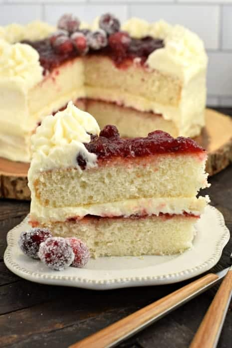 White layered cake with cranberry filling.