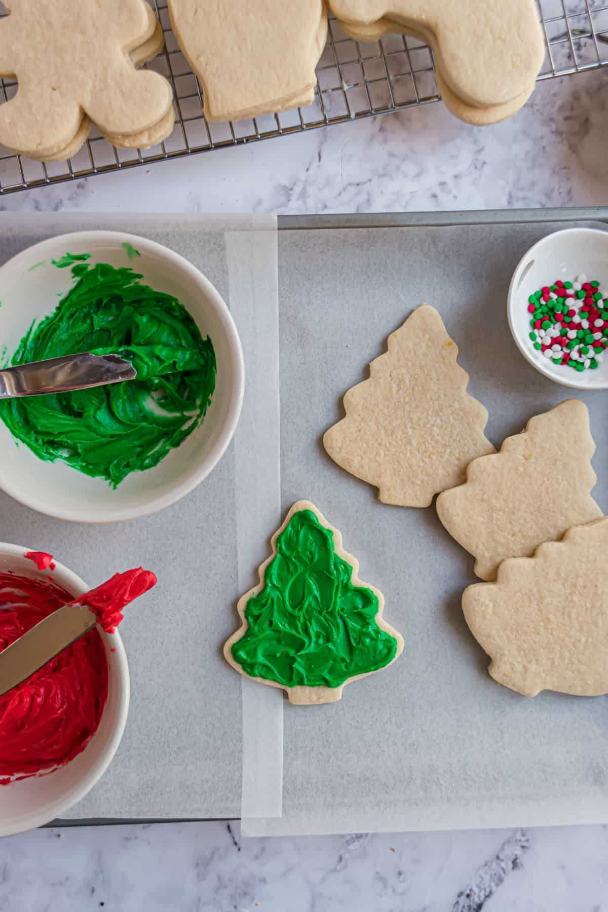 Christmas tree cut out sugar cookies with vanilla bean frosting tinted green.