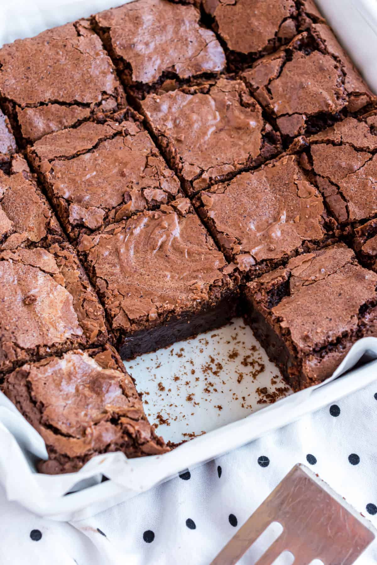 Pan of fudgy brownies with one slice removed.