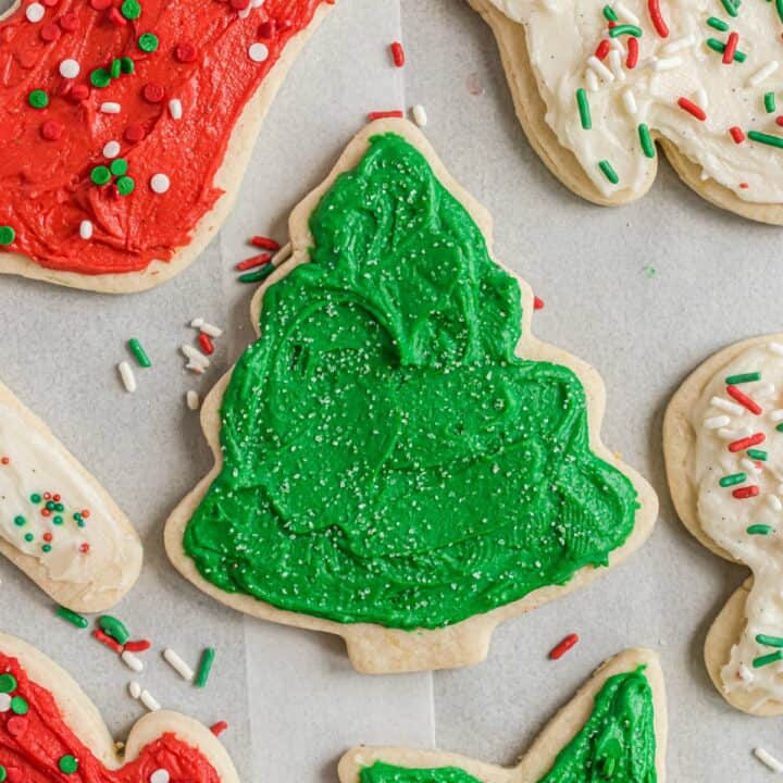 Cut out sugar cookies shaped for christmas and decorated with red and green frosting.