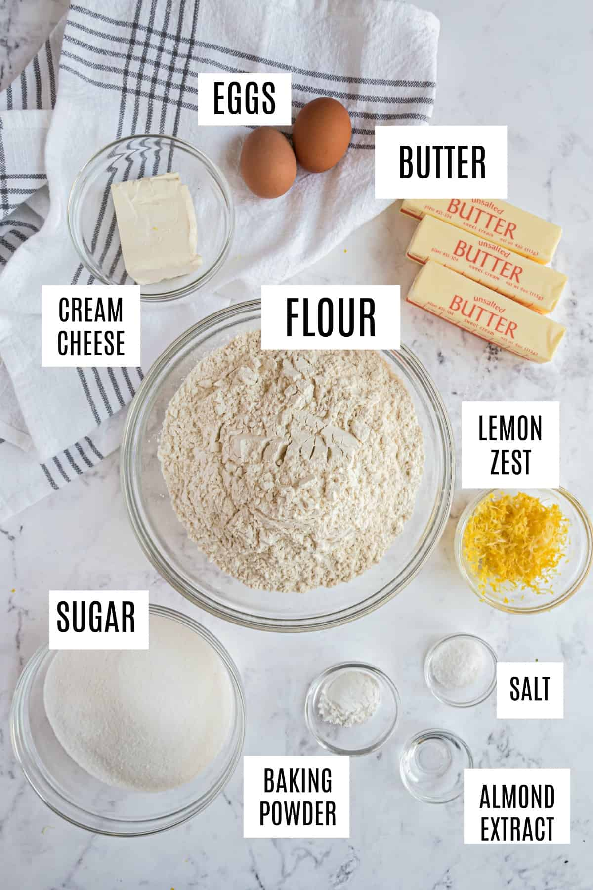 Ingredients needed for cut out sugar cookies including butter, cream cheese, and sugar.