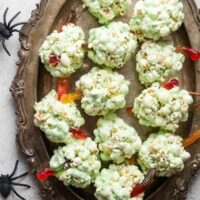 EASY Popcorn Balls with gummy worms for Halloween! Only 5 ingredients.
