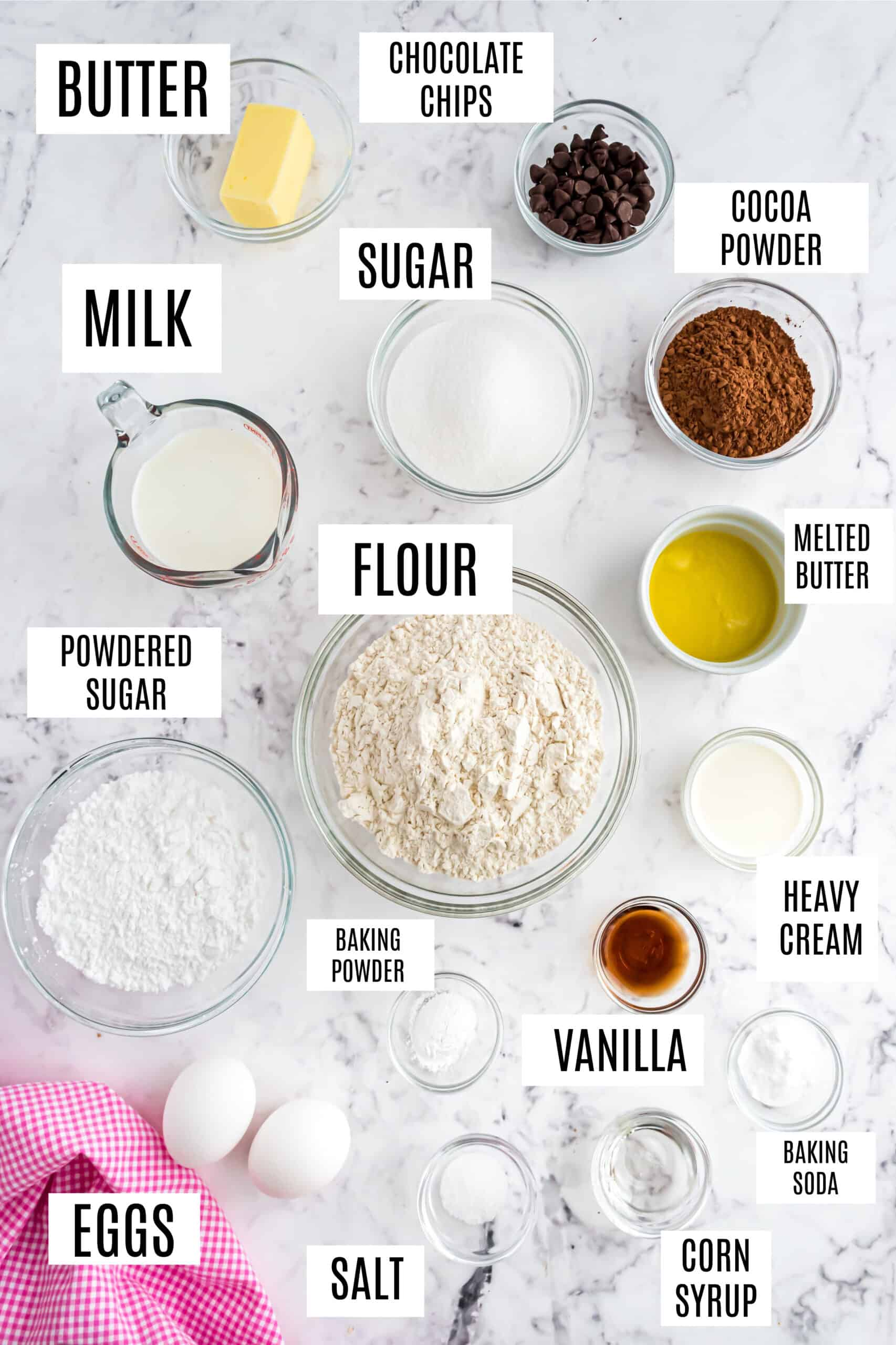 Ingredients needed to make baked chocolate donuts.
