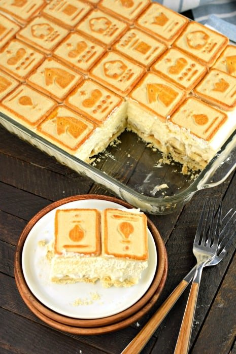 Banana pudding topped with chessmen cookies in 13x9 dish.