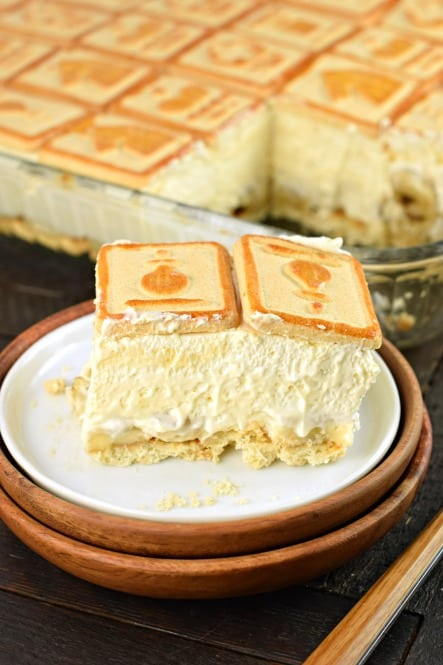 Slice of thick, creamy banana pudding with chessmen cookies on top.