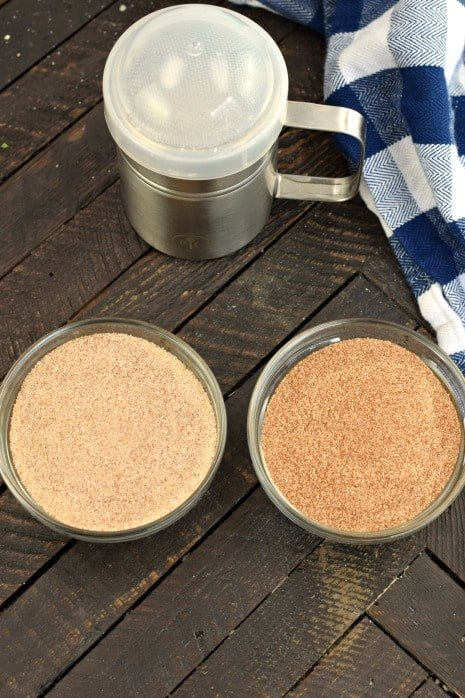 Two strengths of cinnamon sugar mix in two clear glass bowls.