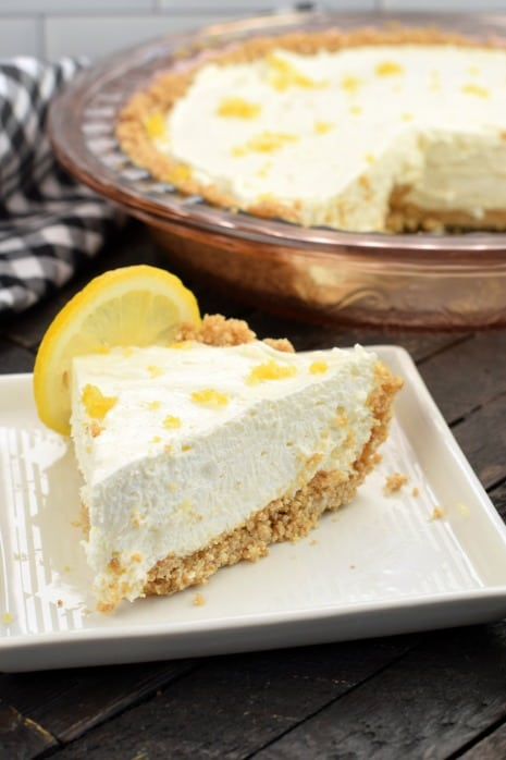 Big slice of no bake cheesecake with lemon on a square dessert plate.