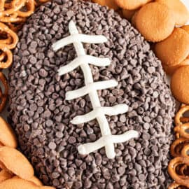 Football shaped oreo cheese ball with nilla wafers and pretzels.