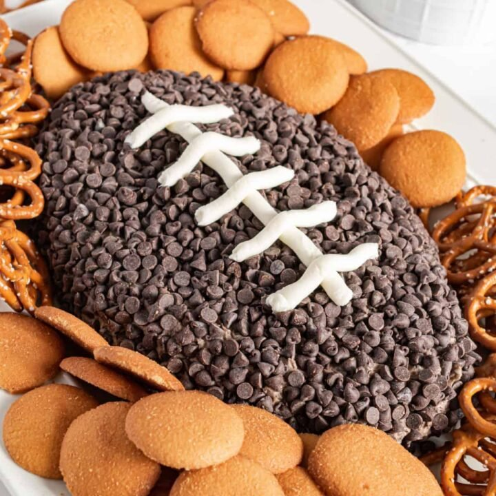 Cookies and cream cheese ball shaped like a football for game day.