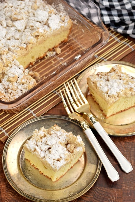 Top view of two slices of crumb cake with two forks.