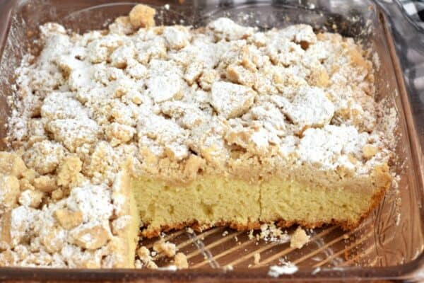 Pan of New York style Crumb Cake with powdered sugar.