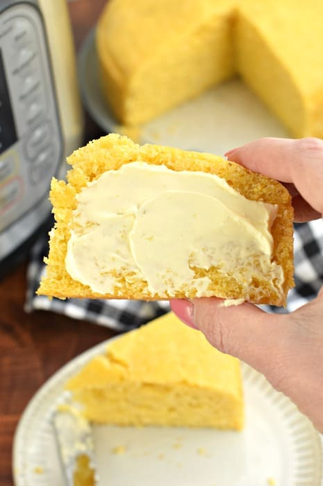 Slice of corn bread with butter.