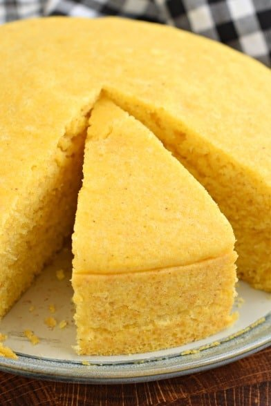 Thick slice of cornbread cut out of the whole pan.