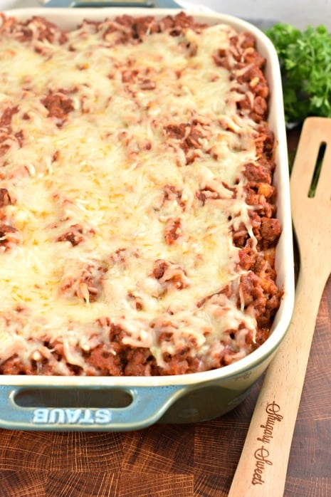 Rectangle baking dish with baked pasta and cheese.