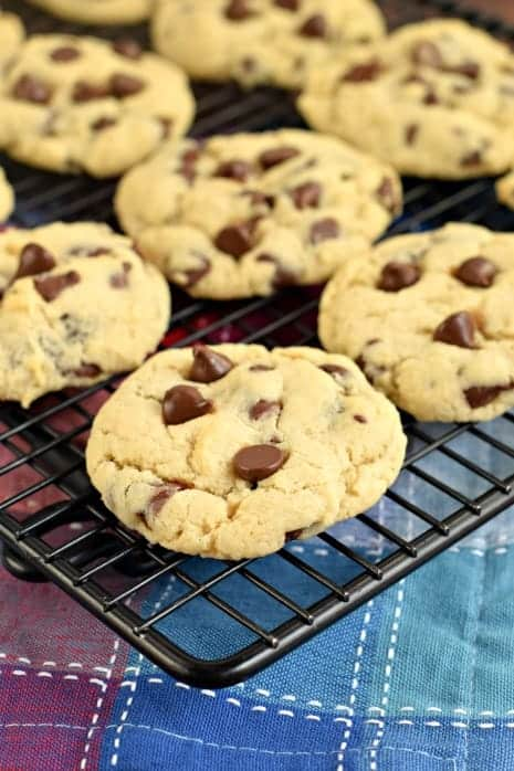 Chocolate Chip Cookies on black wire cooling rack.