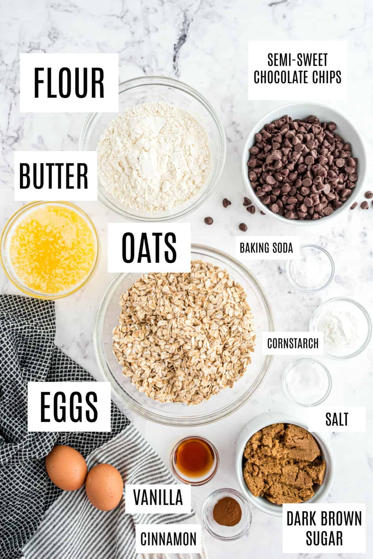 Ingredients needed for oatmeal chocolate chip cookies including butter and old fashioned oats.